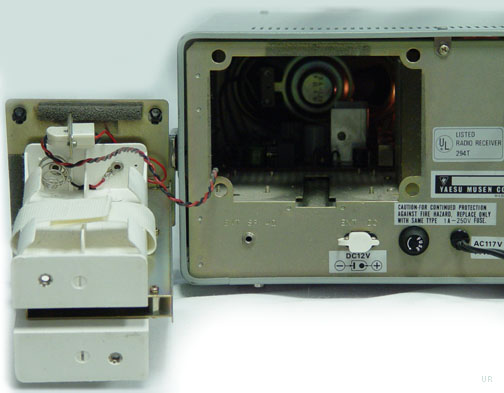 there is a carry handle on the right side  the rear panel has high and low  impedance antenna inputs  the frg-7 operates from 120 vac, 13 vdc or 8 d  cells
